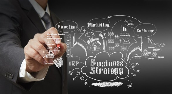 Photo: business man writing business strategy concept by Phenom Apps