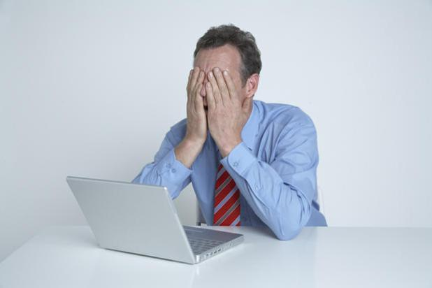 40154557-1-610-head-in-hands-man-frustrated-laptop
