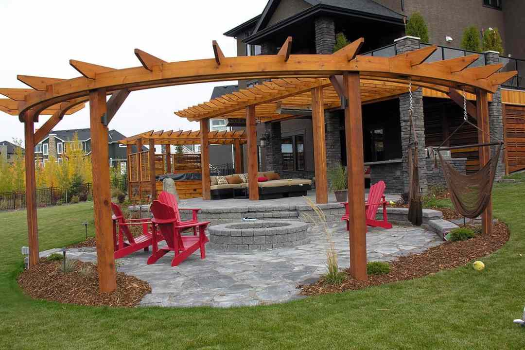 beautiful wooden pergola with a firepit, landscape designer in calgary