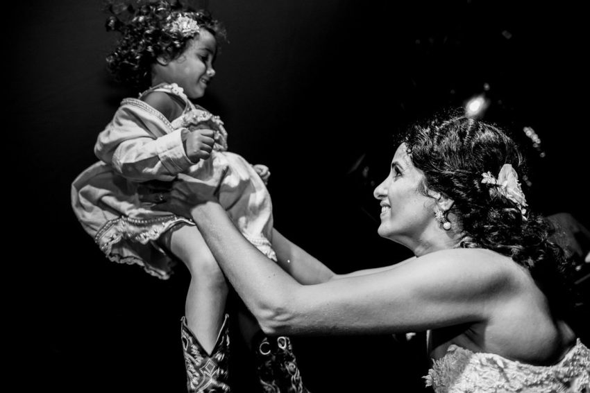 bride and kid sharing happiness