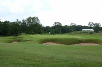 The view of the 5th green from front left, showing four of the five bunkers that guard the putting surface.
