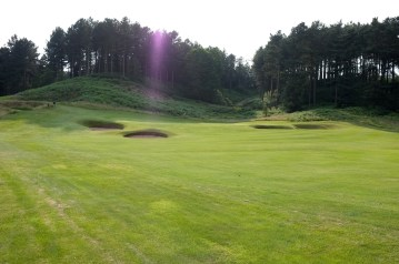 The view of the approach to the 17th green from the left-hand rough.
