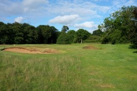 The view of the approach to the 10th green, showing the two bunkers that sit just in front of the putting surface.