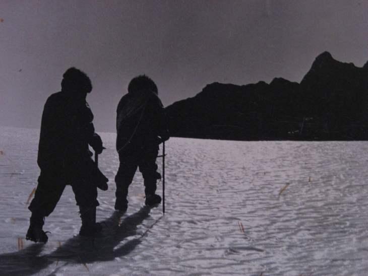 Glacier cromponeering Mt Henderson inland from Mawson Station.