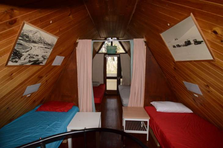 ANARE Ski Lodge - Bedrooms with heavy curtain divide. During COVID-19 pillows and blankets not supplied.