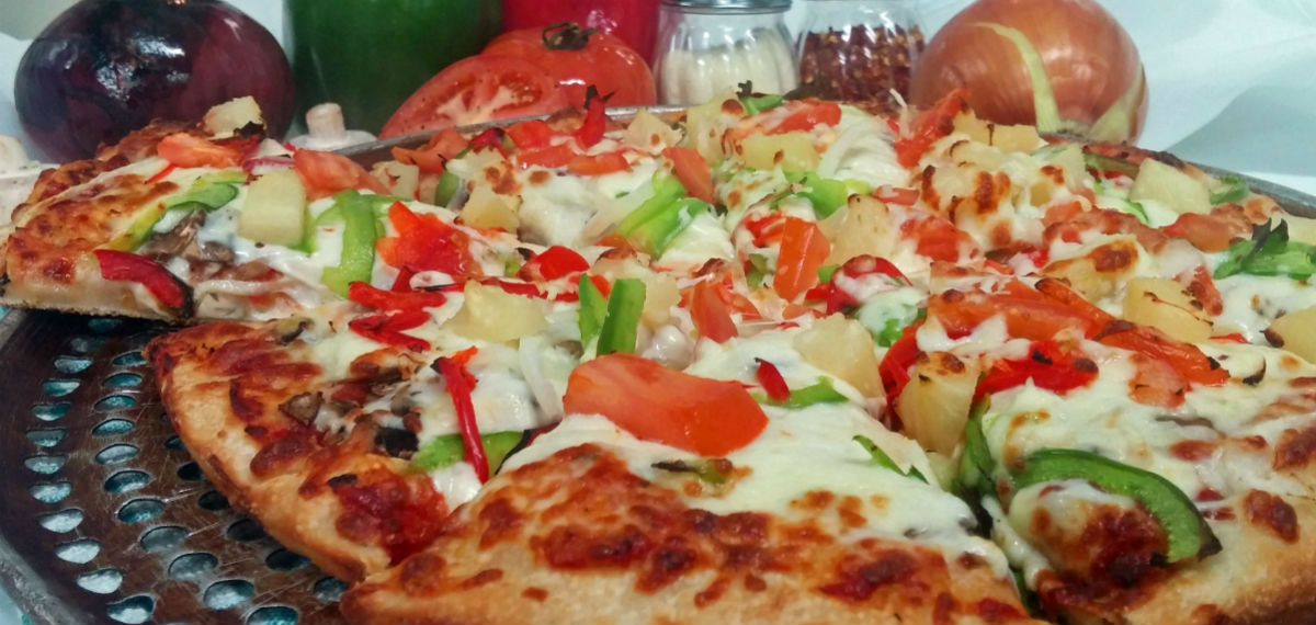 Fresh Veggie Pizza Sliced And Ready to eat - Best Pizza in Lumby