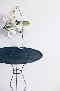 magnolia wallhanging and antique table / stylist Anastasia Benko