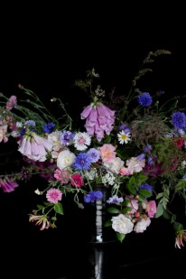 moody wild flower arrangement with bachelor buttons, foxgloves, wild carrot, wild roses