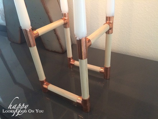 candles on wood holder