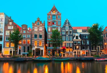 30718946 - night city view of amsterdam canals and typical houses, boats and bicycles, holland, netherlands.