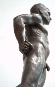 caudal lateral view of bronze sculpture of male nude standing figure