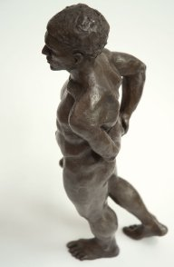 cranial lateral view of bronze sculpture of male nude standing figure