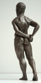 dorsal lateral view of bronze sculpture of male nude standing figure