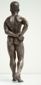 dorsal view of bronze sculpture of male nude standing figure