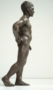 lateral dorsal view of bronze sculpture of male nude standing figure