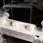Bread loaves on a conveyor belt in a factor