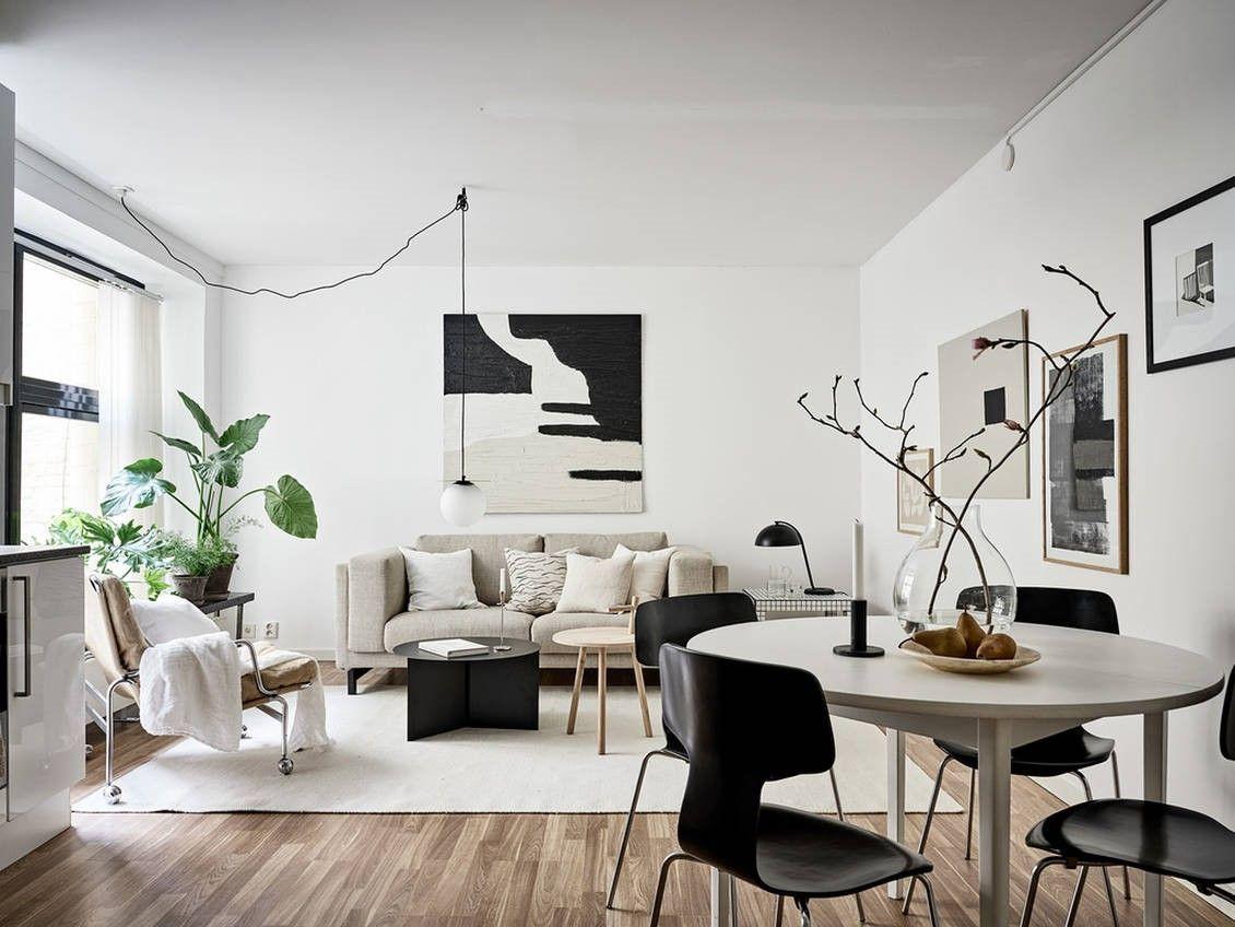 Tendencias en estilos de decoración de interiores: nuevo estilo nórdico, espacio de salón comedor en tonos neutros, salpicado de grandes plantas @Utrillanais