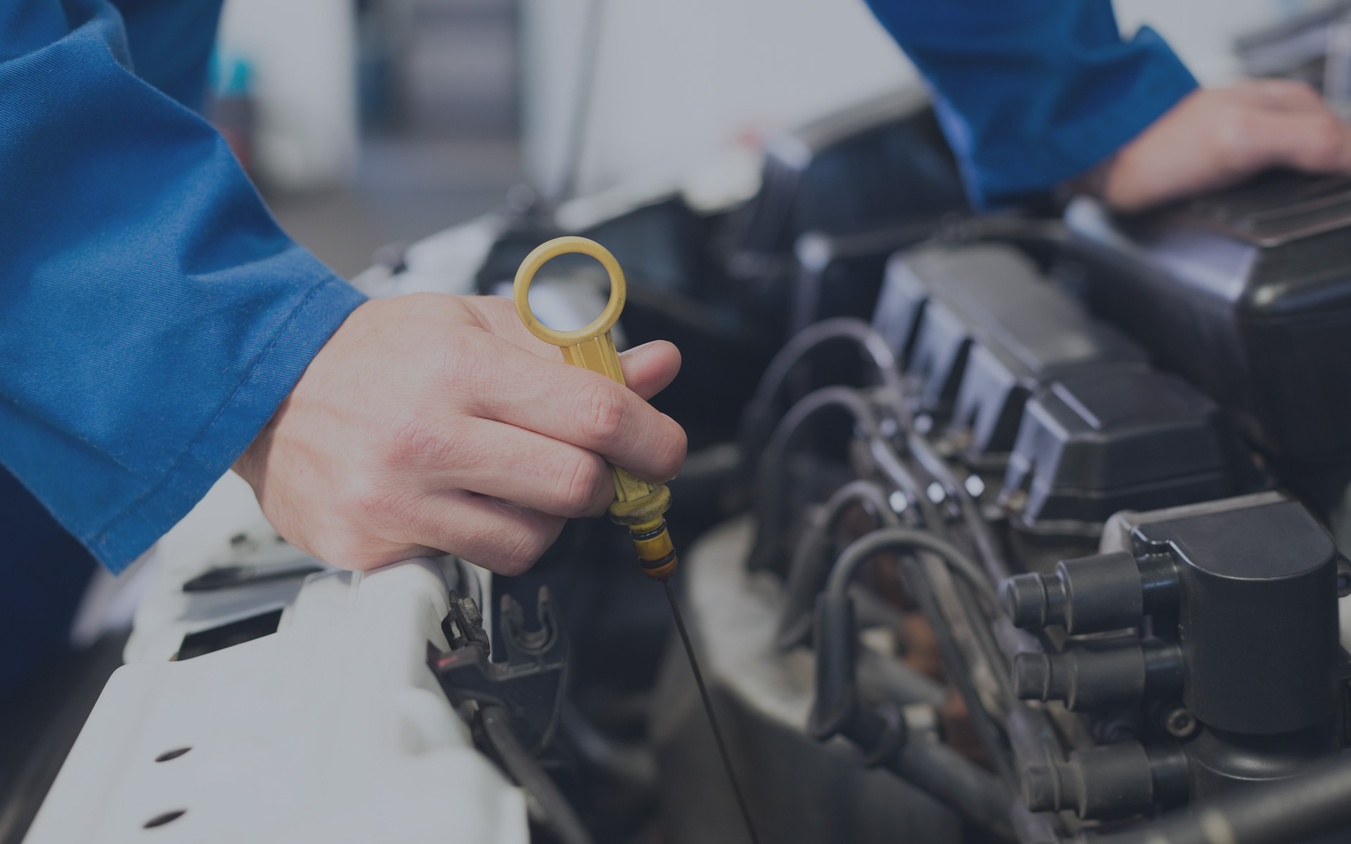 A&C Auto Center Mechanic Checking Oil