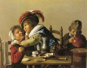 Tres niños en una mesa
