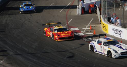 RACE IS STILL LEGAL — Pirelli World Challenge cars compete in the 2015 Long Beach Grand Prix. Under the withdrawn EPA rule modifications of such street legal exotics for racing would have become illegal.