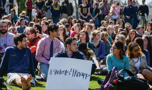 TAKING A STANCE— Students sit in the Pine Grove in order to support President John Knapp. The rumored dismissal has caused an uproar from many students.