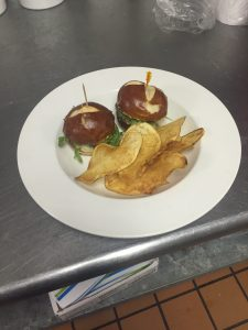 Awesome Bacon Jam Sliders on Cheese Pretzel buns with Arugula and Gorgonzola.