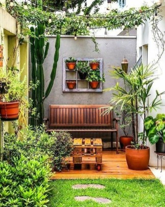 Basic Exterior Wall Into an Elegant Vertical Garden to Perfect Your Garden 16