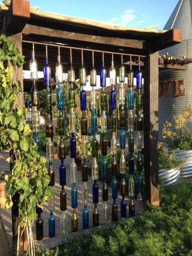 Charming Backyard Ideas Using an Empty Glass Bottle15