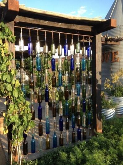 Charming Backyard Ideas Using an Empty Glass Bottle15
