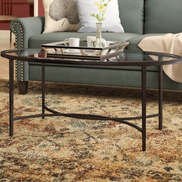 The Charm of Homely Contemporary Living rooms with Oval Coffee Table Decorations 25