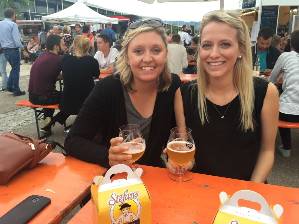 Two women with beers at a Freiburg beer garden.