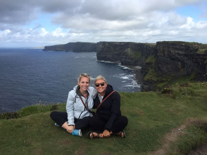Two women at the Cliffs of Moher.