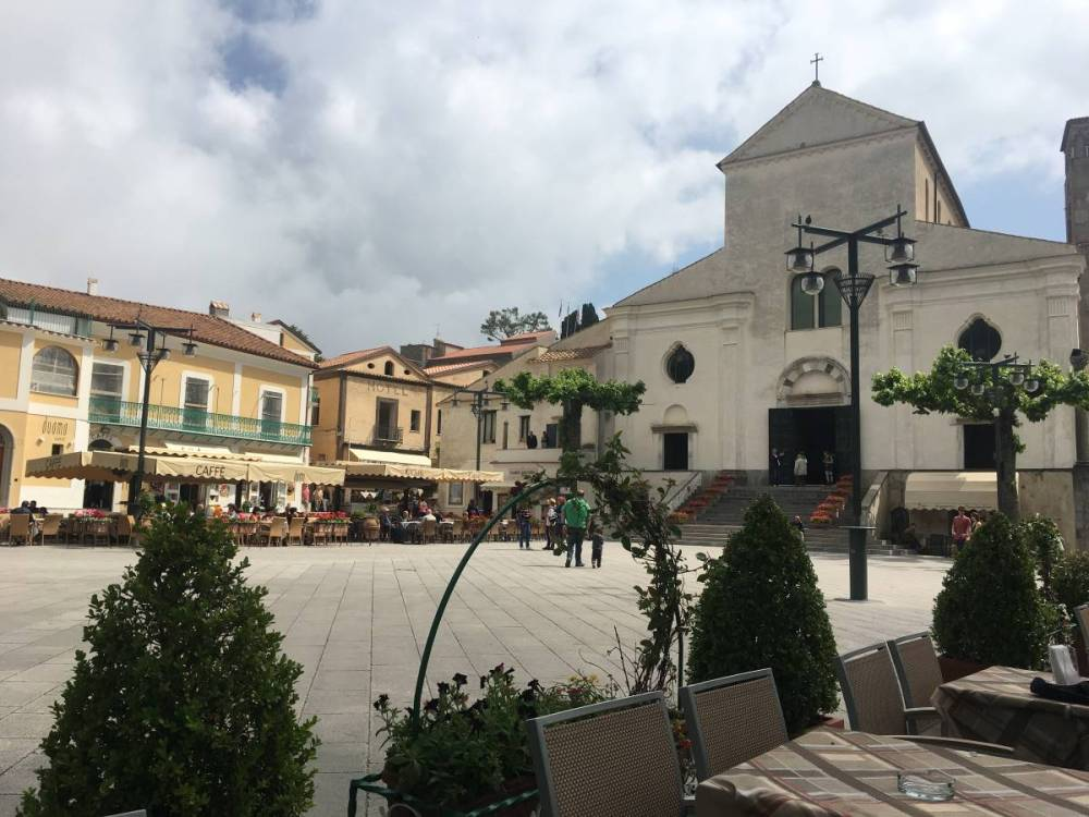 A photo taken from a cafe in the Ravello town square overlooking the Ravello church.