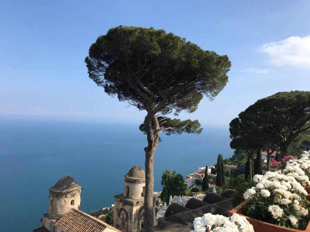 A view of the gardens and coastline from Villa Rufolo in Ravello, Italy. Villa Rufolo is one of two gardens mentioned in the What to do in Ravello travel guide.