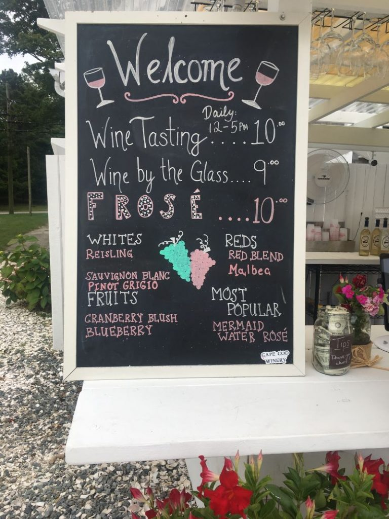 A sign listing the types of wines at the Cape Cod Winery.