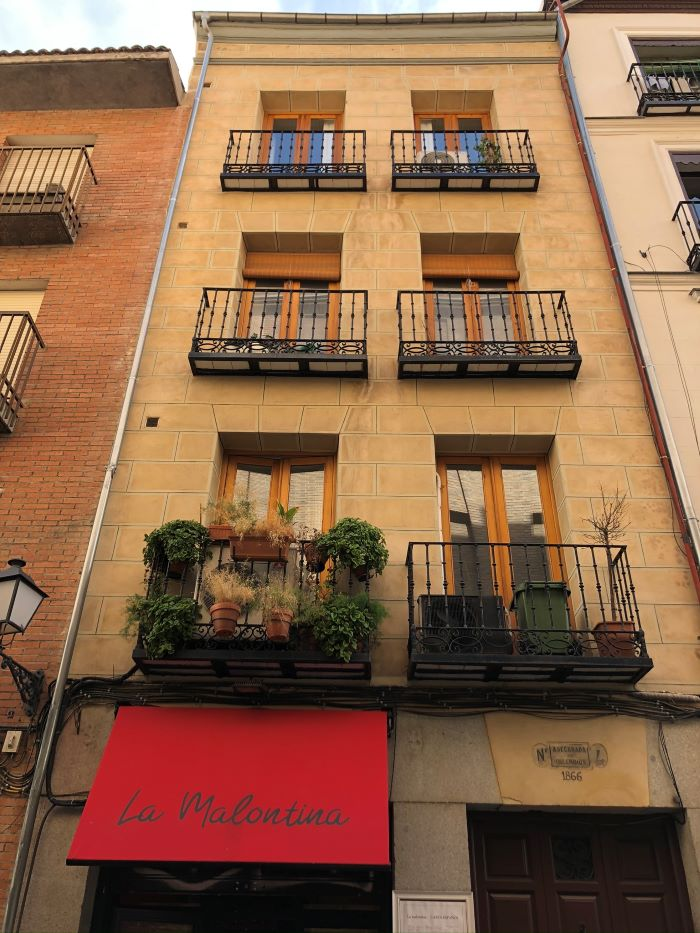 The exterior of a restaurant on a brick building in Madrid.