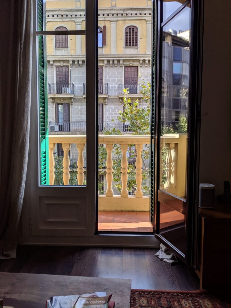 The view from inside a Barcelona accommodation is a yellow balcony and yellow shutters.