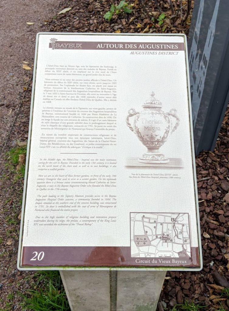 A bronze historical marker on a self guided walking tour.