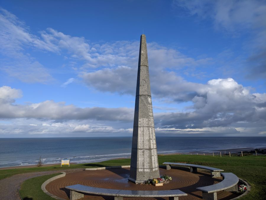 A spire memorial on the cliffs at Omaha Beach in Normandy.
