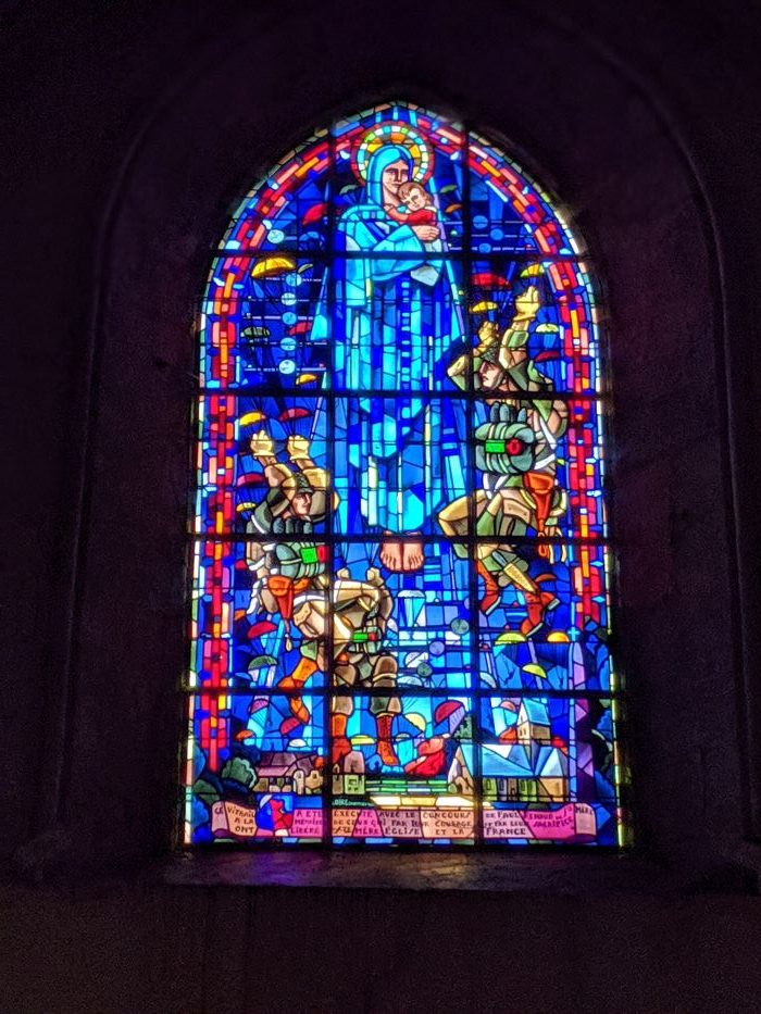 A stained glass window in Saint Mere Eglise church depicts an angel watching over three US paratroopers in Normandy