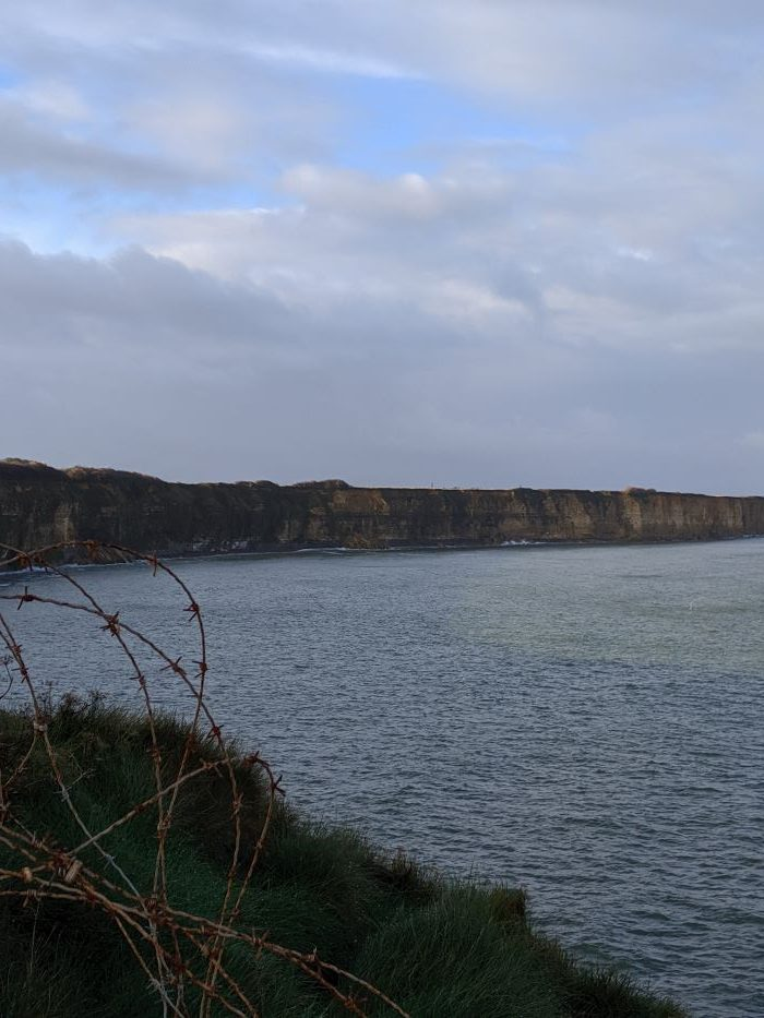 The dramatic cliffs and shoreline of Pointe du Hoc in Normandy.