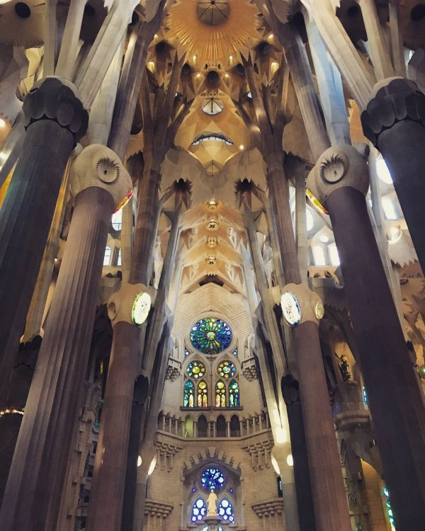 The colorful interior of the ceiling and columns inside La Sagrada Familia in barcelona.
