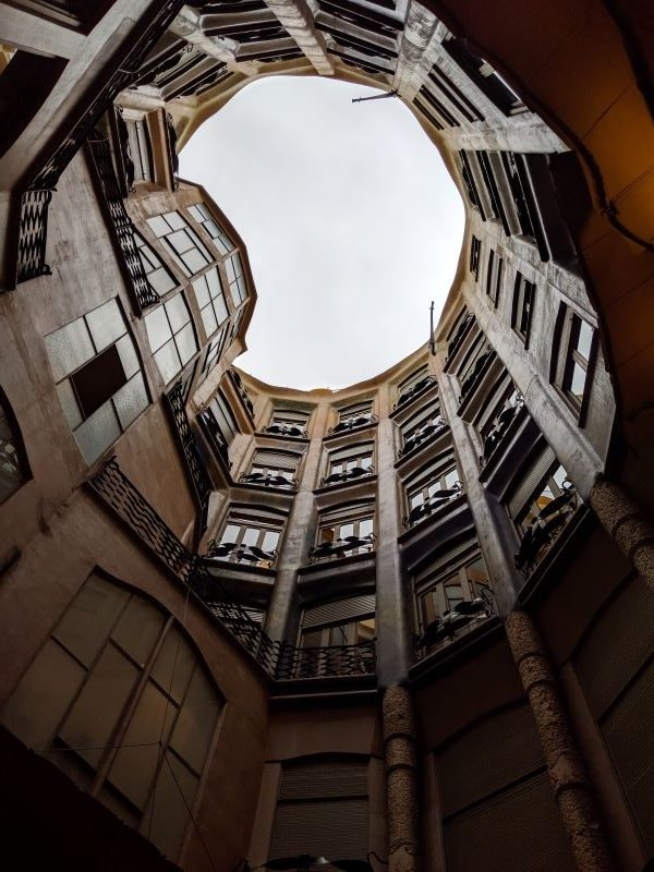The interior view of apartment windows on a tour of Casa Mila in barcelona
