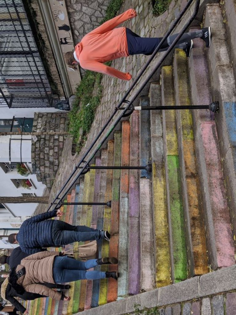 Outdoor steps that have been painted a variety of colors in Montmartre in Paris.