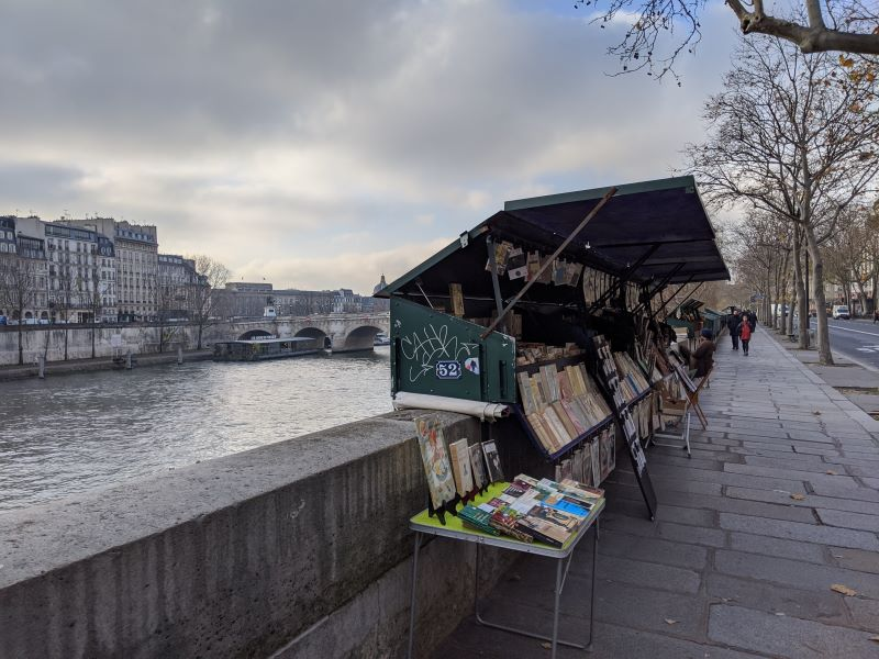 A sidewalk bookstore in Paris located by the Seine River