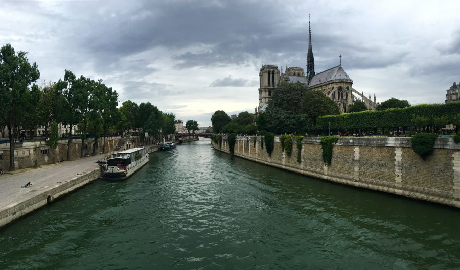 The Seine River in Paris with the Notre-Dame Cathedral in the background.