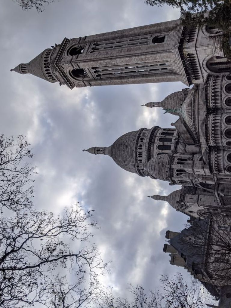 The massive, gray Sacre-Coeur church in the Montmartre neighborhood in Paris.