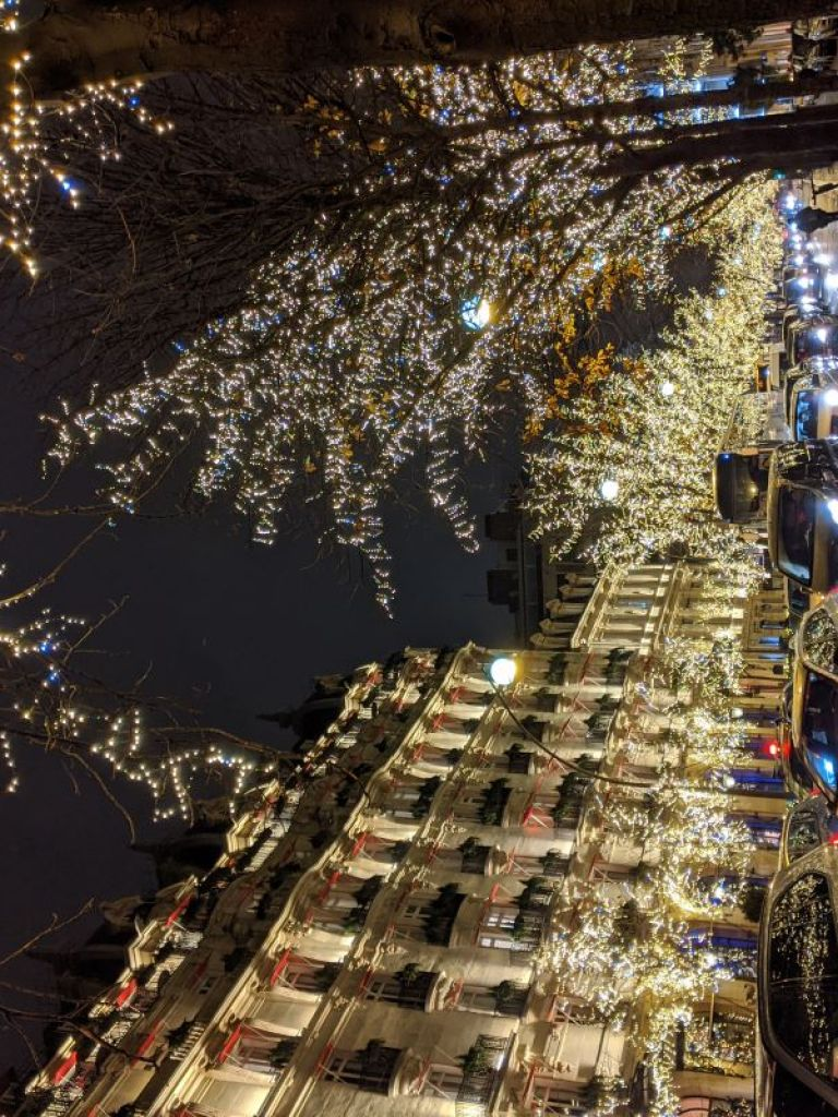 Glowing Christmas Lights on a busy street in Paris