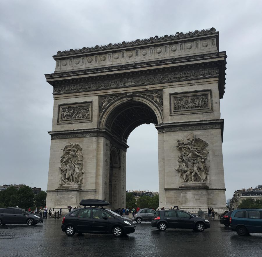 The Arc de Triomphe in Paris is an arch-shaped monument built in the middle of a busy intersection.