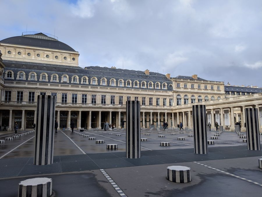 Black and white column caps of different sizes in a square in Paris.